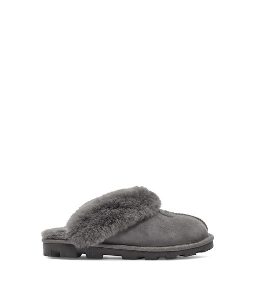 UGG Women's Coquette Slipper In Grey, Size 5 Take your self-care seriously with this slipper. As soft as it is versatile, the Coquette features our soft sheepskin and a lightweight sole that travels both indoors and out with ease. Pair with athleisure basics or a midi skirt and tank for casual daytime wear. This product was made in a factory that supports women in our supply chain with the help of HERproject, a collaborative initiative that creates partnerships with brands like ours to empower and educate women in the workplace. UGG Women's Coquette Slipper In Grey, Size 5