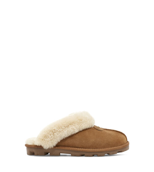 UGG Women's Coquette Slipper In Brown, Size 10 Take your self-care seriously with this slipper. As soft as it is versatile, the Coquette features our soft sheepskin and a lightweight sole that travels both indoors and out with ease. Pair with athleisure basics or a midi skirt and tank for casual daytime wear. This product was made in a factory that supports women in our supply chain with the help of HERproject, a collaborative initiative that creates partnerships with brands like ours to empower and educate women in the workplace. UGG Women's Coquette Slipper In Brown, Size 10